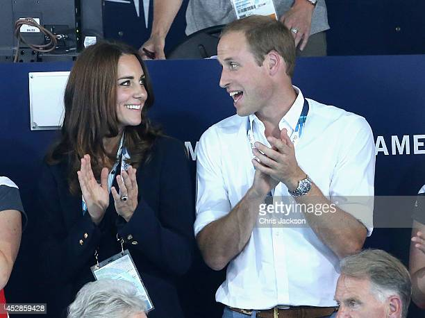 Catherine Duchess of Cambridge and Prince William Duke of Cambridge watch the swimming at Tollcross Swimming Centre during the 20th Commonwealth...