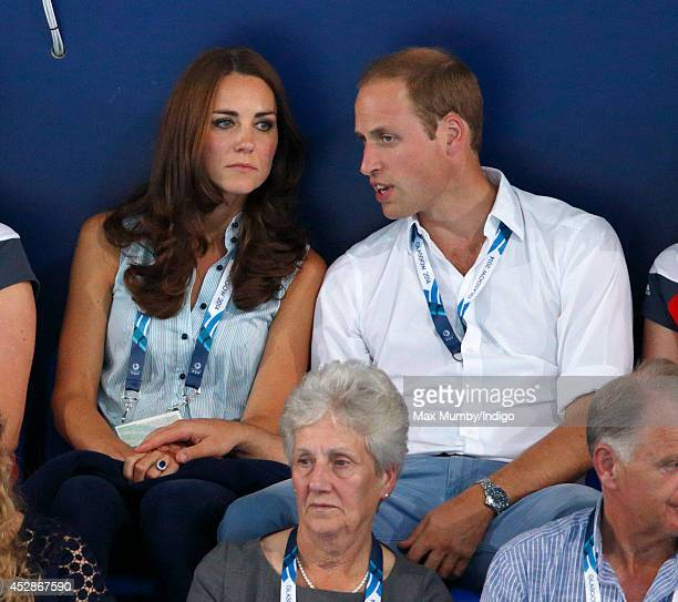 Catherine Duchess of Cambridge and Prince William Duke of Cambridge watch the swimming at the Tollcross International Swimming Centre during the 20th...