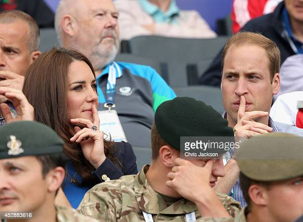 Catherine Duchess of Cambridge and Prince William Duke of Cambridge watch the athletics at Hampden Park as they attend day six of the Commonwealth...