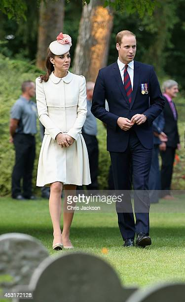 Catherine Duchess of Cambridge and Prince William Duke of Cambridge walk through war graves at St Symphorien Military Cemetery on August 4 2014 in...