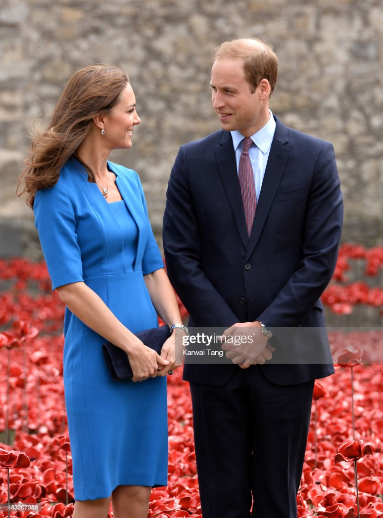 Catherine, Duchess of Cambridge and Prince William, Duke of Cambridge visit the Tower of London's 'Blood Swept Lands and Seas of Red' poppy installation in the Tower of London's moat on August 5, 2014 in London, England.