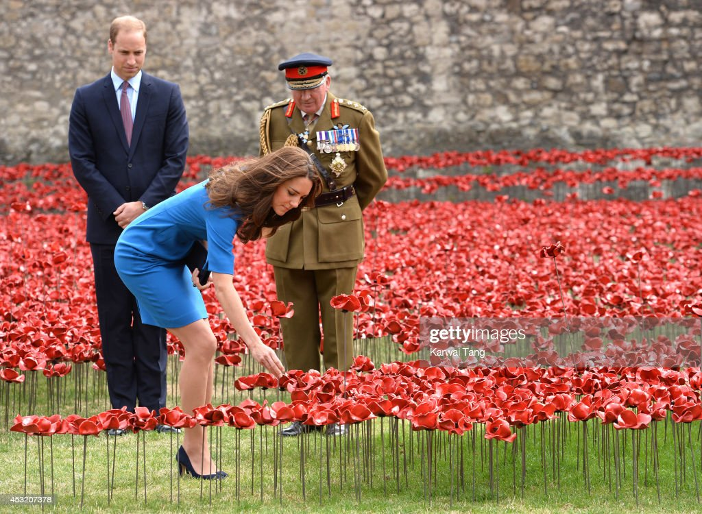 Catherine, Duchess of Cambridge and Prince William, Duke of Cambridge visits the Tower of London's 'Blood Swept Lands and Seas of Red' poppy installation in the Tower of London's moat on August 5, 2014 in London, England.