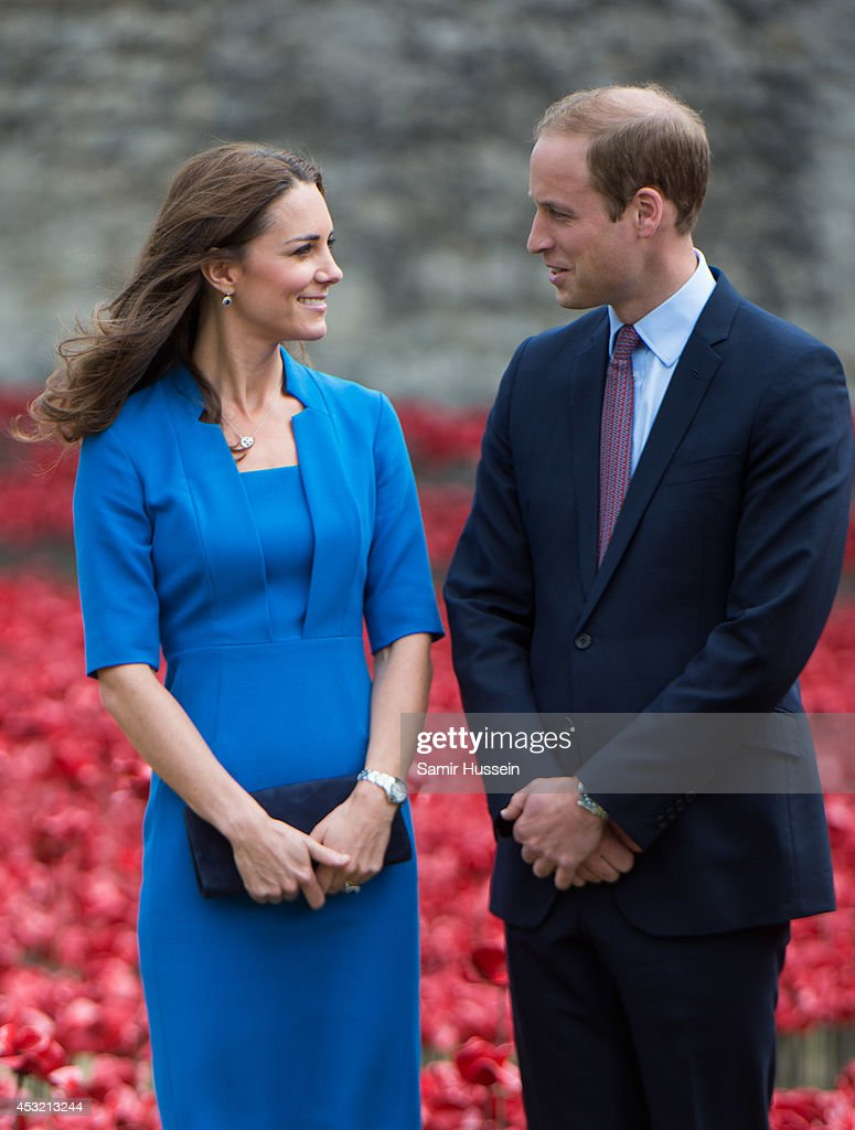 Catherine, Duchess of Cambridge and Prince William, Duke of Cambridge visit The Tower Of London's Ceramic Poppy installation 'Blood Swept Lands and Seas of Red' by artist Paul Cummins, commemortating the 100th anniversary of the outbreak of First World War on August 5, 2014 in London, England.