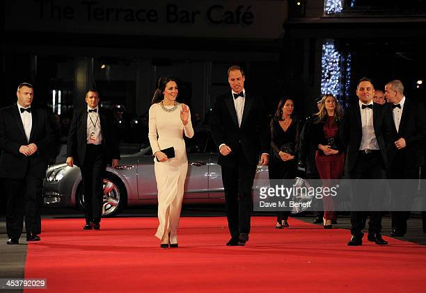 """Catherine, Duchess of Cambridge and Prince William, Duke of Cambridge attend the Royal Film Performance of """"Mandela: Long Walk to Freedom"""" at Odeon..."""