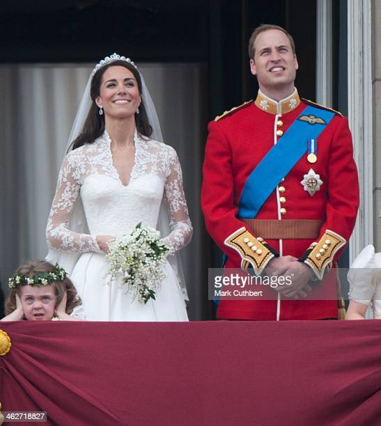 Catherine Duchess of Cambridge and Prince William Duke of Cambridge on the balcony at Buckingham Palace with Bridesmaid Grace Van Cutsem following...