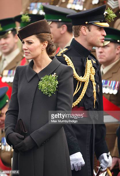 Catherine Duchess of Cambridge and Prince William Duke of Cambridge attend the annual St Patrick's Day Parade at Mons Barracks on March 17 2015 in...