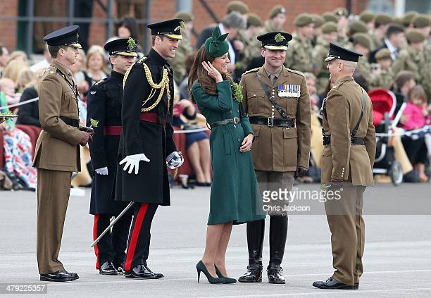 Catherine Duchess of Cambridge and Prince William Duke of Cambridge laugh as they present the 'Shamrocks' during the St Patrick's Day parade at Mons...