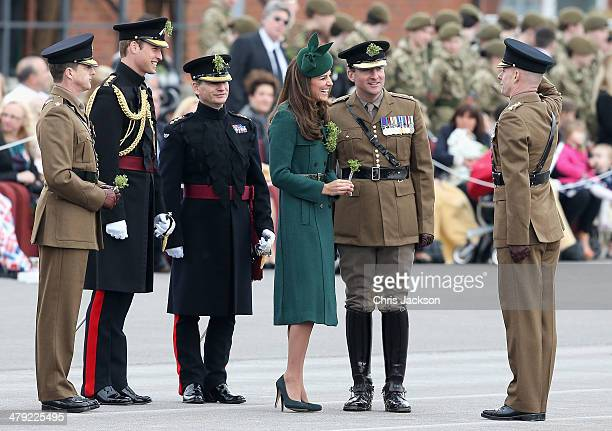 Catherine Duchess of Cambridge and Prince William Duke of Cambridge laugh as they present 'Shamrocks' during the St Patrick's Day parade at Mons...