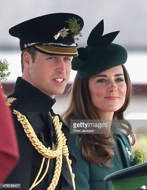 Catherine Duchess of Cambridge and Prince William Duke of Cambridge stand on the dias during the St Patrick's Day parade at Mons Barracks on March 17...
