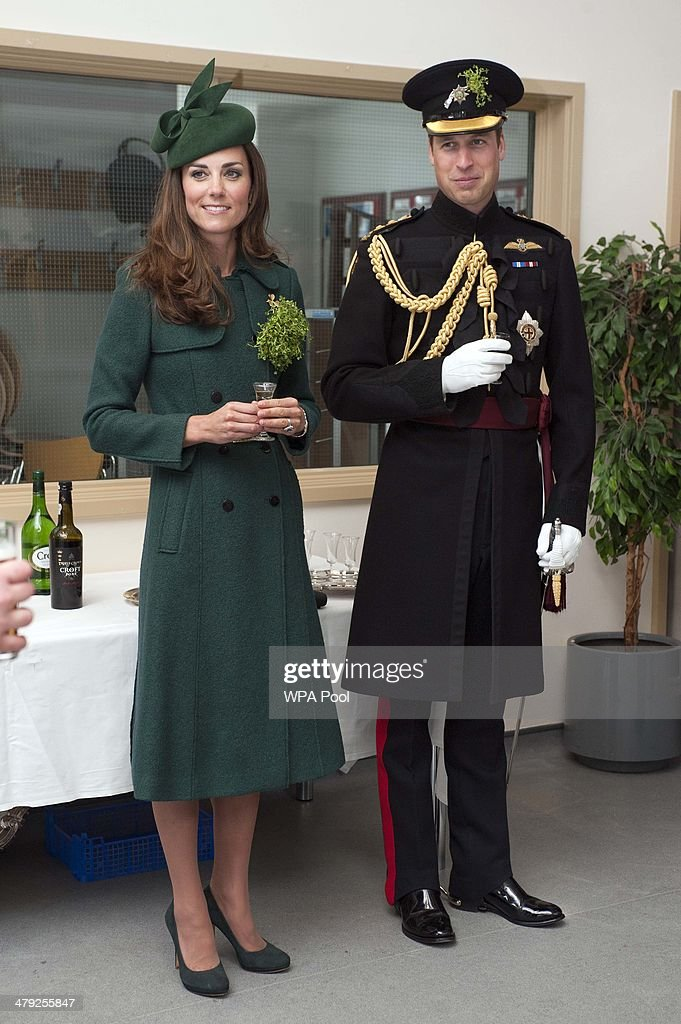 Catherine, Duchess of Cambridge and Prince William, Duke of Cambridge have a drink during the St Patrick's Day parade at Mons Barracks on March 17, 2014 in Aldershot, England. Catherine, Duchess of Cambridge and Prince William, Duke of Cambridge visited the 1st Battalion Irish Guards to present the traditional sprigs of Shamrocks to the Officers and Guardsmen of the Regiment.