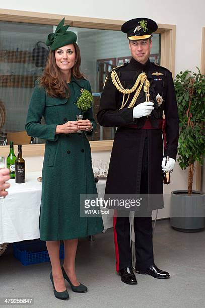 Catherine Duchess of Cambridge and Prince William Duke of Cambridge have a drink during the St Patrick's Day parade at Mons Barracks on March 17 2014...
