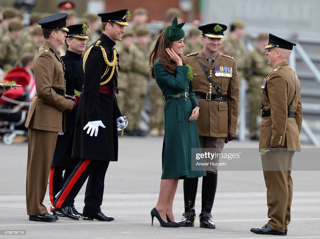 Catherine, Duchess of Cambridge and Prince William, Duke of Cambridge chat to soldiers during the St. Patrick's Day Parade at Mons Barracks on March 17, 2014 in Aldershot, England.
