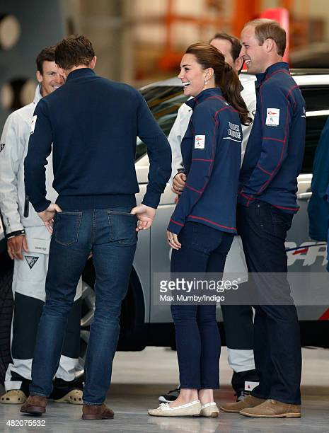 Catherine Duchess of Cambridge and Prince William Duke of Cambridge talk with Sir Ben Ainslie during a visit to the Ben Ainslie Racing team base as...