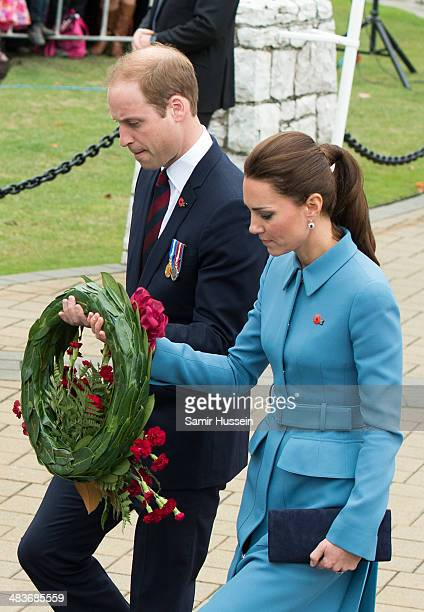 Catherine, Duchess of Cambridge and Prince William, Duke of Cambridge lay a wreath during a wreathlaying service at the War Memorial in Seymour...