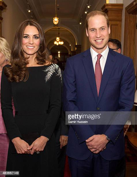 Catherine, Duchess of Cambridge and Prince William, Duke of Cambridge pose together at the unveiling a portrait of Queen Elizabeth II, painted by New...