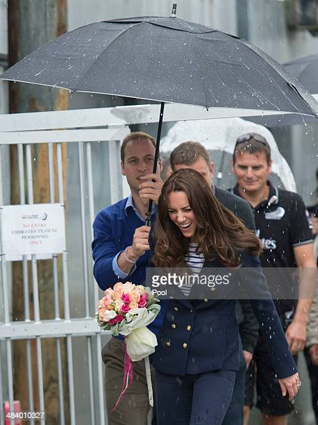 Catherine Duchess of Cambridge and Prince William Duke of Cambridge arrive at Auckland Harbour in the rain on April 11 2014 in Auckland New Zealand...