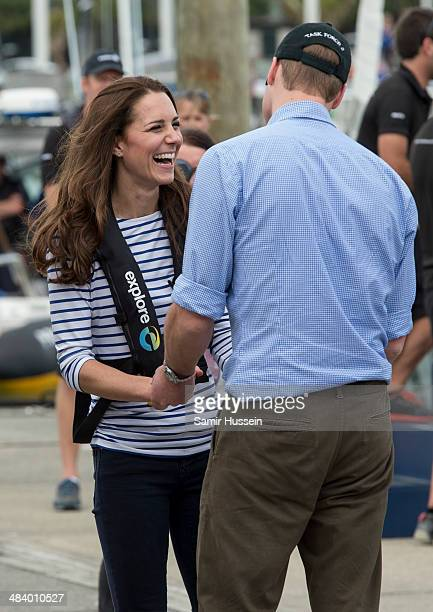 Catherine Duchess of Cambridge and Prince William Duke of Cambridge joke together after sailing during their visit to Auckland Harbour on April 11...