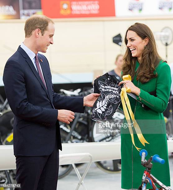 Catherine Duchess of Cambridge and Prince William Duke of Cambridge are given a mini cycling shirt for Prince George as a gift as they visit the...