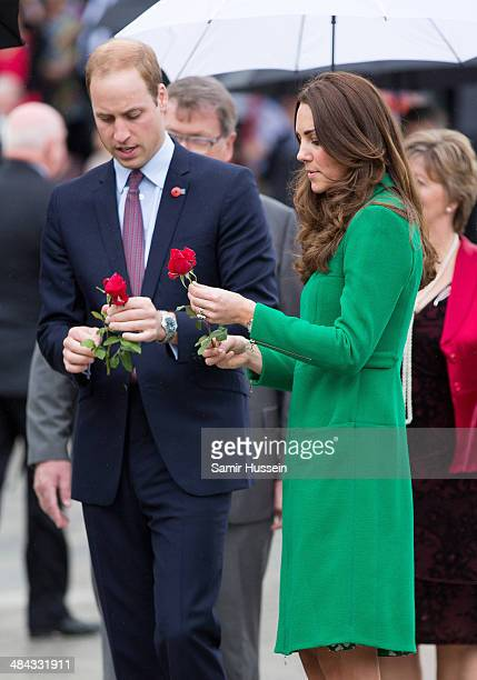 Catherine Duchess of Cambridge and Prince William Duke of Cambridge place a flower on the War Memorial as she visits the Cambridge Town Hall on April...