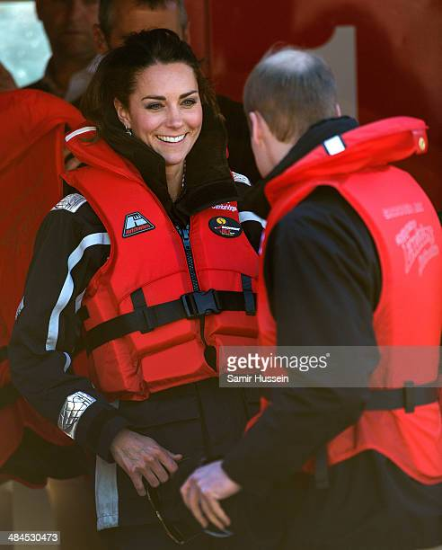Catherine Duchess of Cambridge and Prince William Duke of Cambridge wear a life jacket for their ride on the Shotover Jet on the Shotover River on...