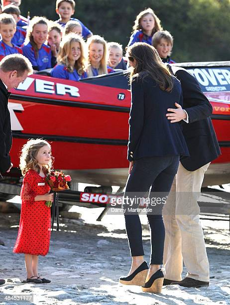 Catherine Duchess of Cambridge and Prince William Duke of Cambridge meet local girl Maggie Langford on a visit to the Shotover Jet on the Shotover...