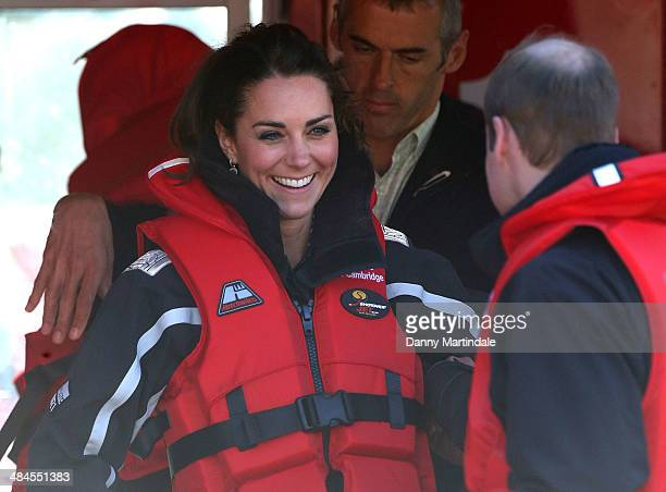 Catherine Duchess of Cambridge and Prince William Duke of Cambridge joke during a visit to the Shotover Jet on the Shotover River on April 13 2014 in...