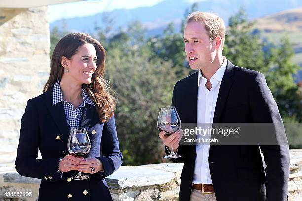 Catherine Duchess of Cambridge and Prince William, Duke of Cambridge sample red wine as the visit Otago Wines at Amisfield winery on April 13, 2014...