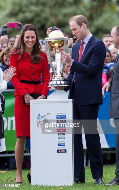 Catherine Duchess of Cambridge and Prince William Duke of Cambridge with the Cricket World Cup in Latimer Square Gardens on April 14 2014 in...