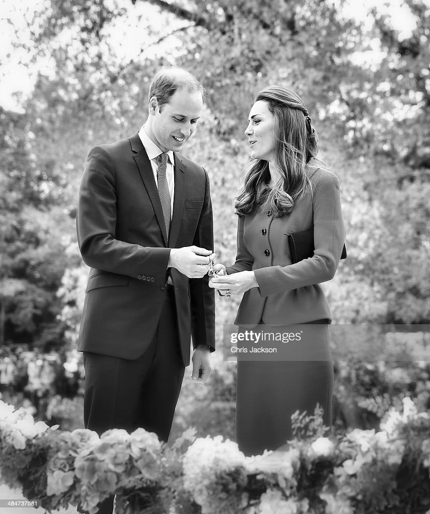 Catherine Duchess of Cambridge and Prince William, Duke of Cambridge prepare to cut the 'flower ribbon' when they officially open the Visitor's Centre at the Botanical Gardens on April 14, 2014 in Christchurch, New Zealand. The Duke and Duchess of Cambridge are on a three-week tour of Australia and New Zealand, the first official trip overseas with their son, Prince George of Cambridge.