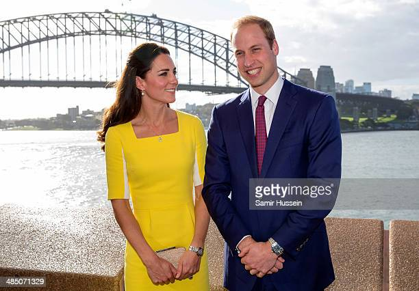 Catherine Duchess of Cambridge and Prince William Duke of Cambridge pose in front of Sydney Harbour Bridge as they visit the Sydney Opera House on...