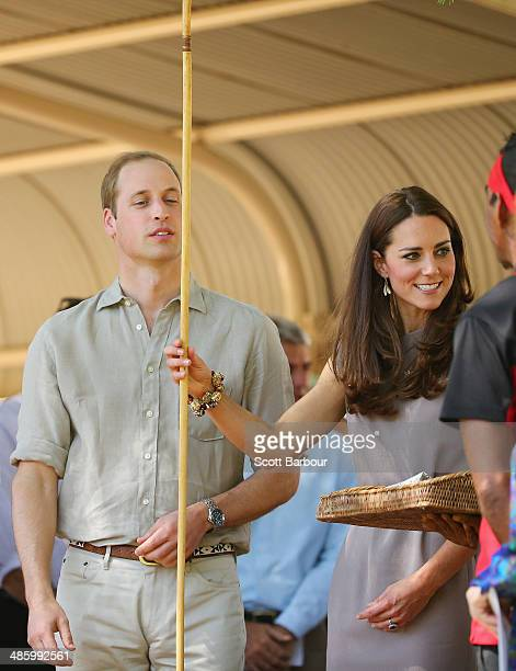 Catherine Duchess of Cambridge and Prince William Duke of Cambridge are presented with an Aboriginal spear as they arrive at the National Indigenous...