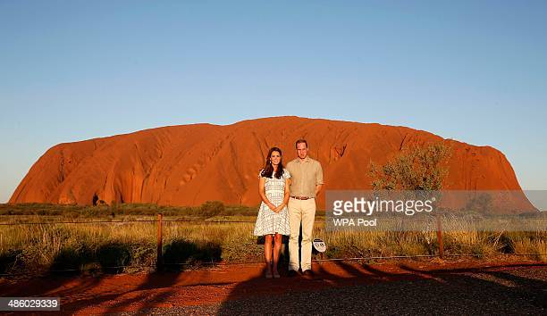 Catherine, Duchess of Cambridge and Prince William, Duke of Cambridge pose in front of Uluru, also known as Ayers Rock, on April 22, 2014 in Ayers...