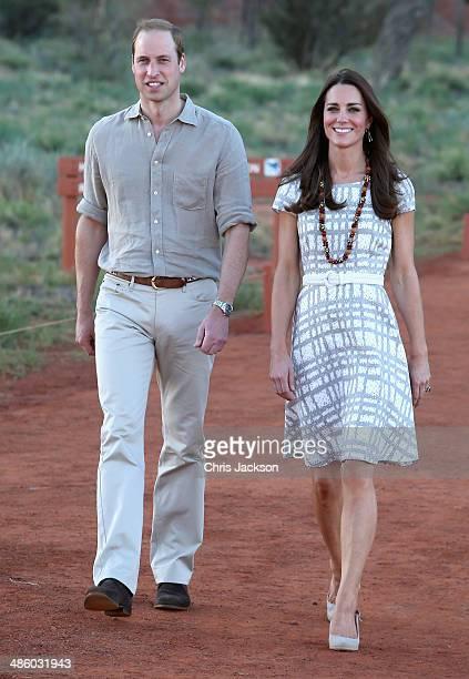 Catherine, Duchess of Cambridge and Prince William, Duke of Cambridge walk around the base of Uluru on April 22, 2014 in Ayers Rock, Australia. The...