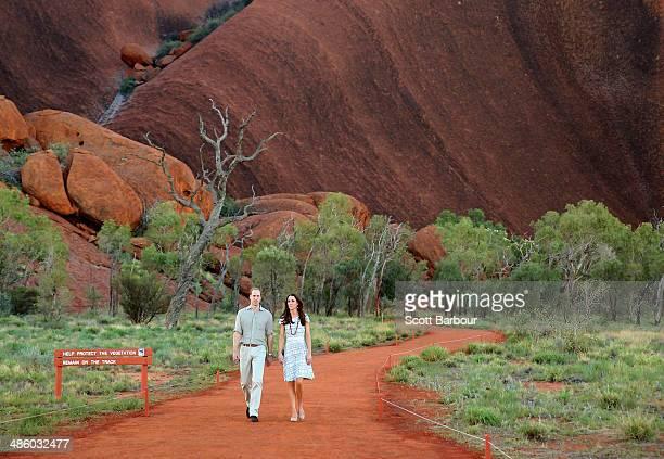 Catherine, Duchess of Cambridge and Prince William, Duke of Cambridge walk down Kuniya Walk at the base of Uluru on April 22, 2014 in Ayers Rock,...