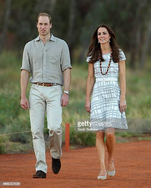 Catherine Duchess of Cambridge and Prince William Duke of Cambridge walk down Kuniya Walk at the base of Uluru on April 22 2014 in Ayers Rock...