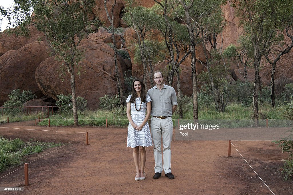 Catherine, Duchess of Cambridge and Prince William, Duke of Cambridge pose for a picture at the Kuniya walk at Uluru on April 22, 2014 in Ayers Rock, Australia. The Duke and Duchess of Cambridge are on a three-week tour of Australia and New Zealand, the first official trip overseas with their son, Prince George of Cambridge.