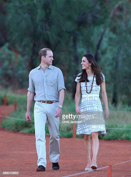Catherine, Duchess of Cambridge and Prince William, Duke of Cambridge walk around the base of Uluru on April 22, 2014 in Ayers Rock, Australia. The...