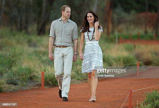 Catherine Duchess of Cambridge and Prince William Duke of Cambridge walk down Kuniya Walk at the base of Uluru on April 22 2014 in Ayers Rock...