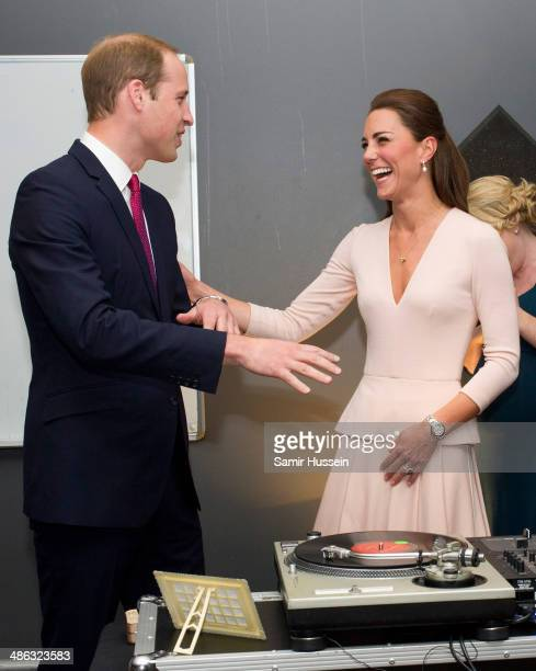 Catherine Duchess of Cambridge and Prince William Duke of Cambridge play on DJ decks at the youth community centre The Northern Sound System in...