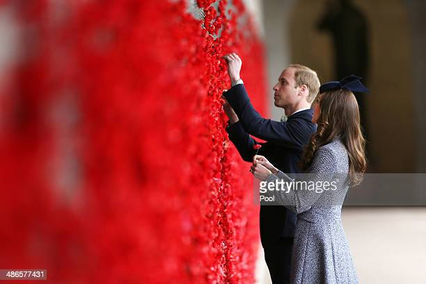 Catherine Duchess of Cambridge and Prince William Duke of Cambridge place a poppy flower into the World War I Wall of Remembrance during their visit...