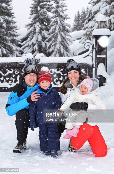 Catherine Duchess of Cambridge and Prince William Duke of Cambridge pose with their children Princess Charlotte and Prince George during a private...