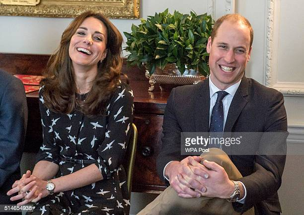 Catherine, Duchess of Cambridge and Prince William, Duke of Cambridge met with Jonny Benjamin and Neil Laybourn at Kensington Palace where they...