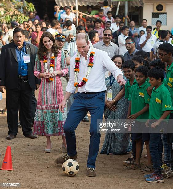 Catherine Duchess of Cambridge and Prince William Duke of Cambridge play football during a visit to the Banganga community on April 10 2016 in Mumbai...
