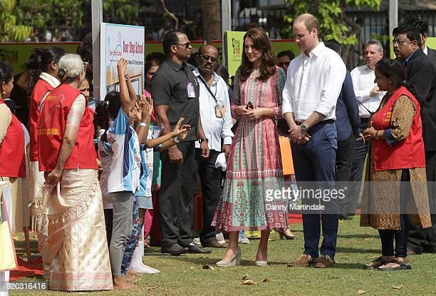 Catherine, Duchess Of Cambridge and Prince William, Duke of Cambridge meet children from Magic Bus, Childline and Doorstep, three non-governmental...
