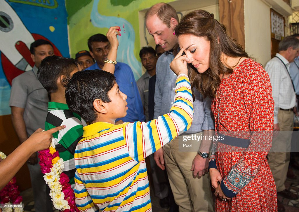 Catherine, Duchess of Cambridge and Prince William, Duke of Cambridge are greeted with a tilak at a contact centre run by the charity Salaam Baalak, which provides emergency help and long term support to homeless children at New Delhi railway station on April 12, 2016 in New Dehli, India. The Duke and Duchess of Cambridge are on a week-long tour of India and Bhutan taking in Mumbai, Delhi, Assam, Bhutan and Agra.