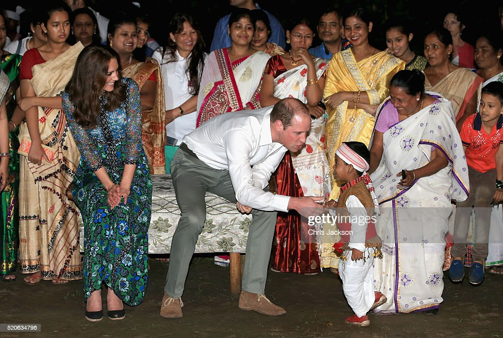 Catherine, Duchess of Cambridge and Prince William, Duke of Cambridge meet a young dancer as they watch dancing by the fireside during a Bihu Festival Celebration at Diphlu River Lodge on day 3 of the royal visit to India and Bhutan on April 12, 2016 in Kaziranga, India. The Duke and Duchess of Cambridge are on a week-long tour of India and Bhutan taking in Mumbai, Delhi, Assam, Bhutan and Agra.