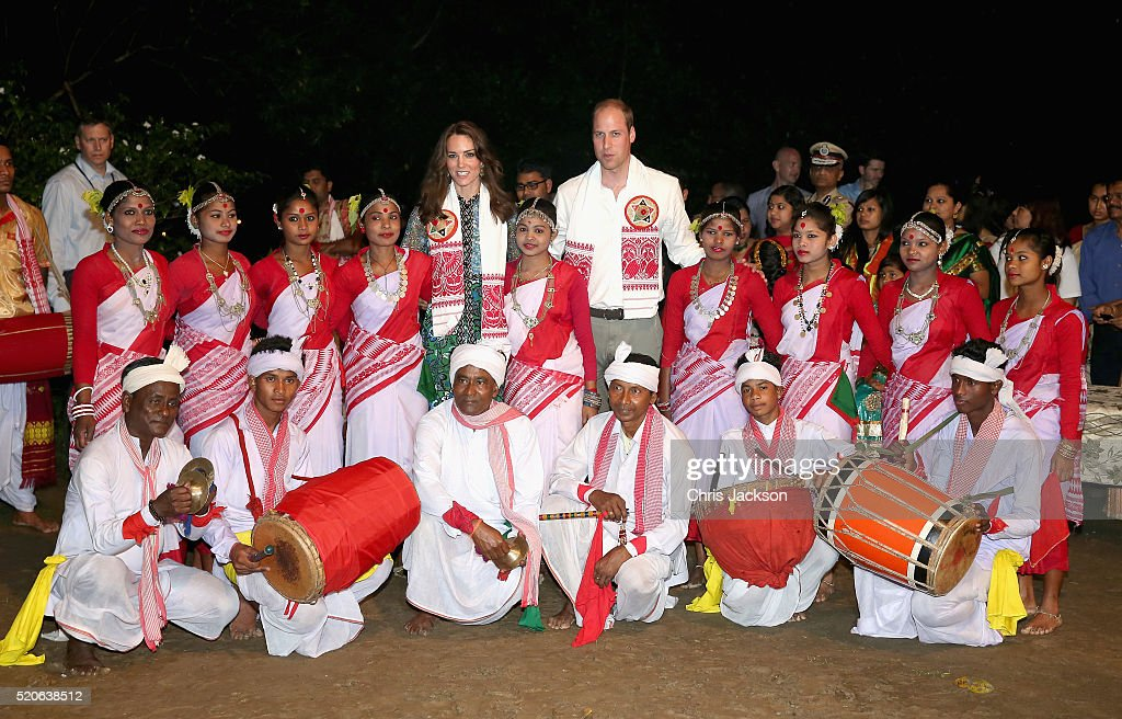 Catherine, Duchess of Cambridge and Prince William, Duke of Cambridge pose with dancers by the fireside during a Bihu Festival Celebration at Diphlu River Lodge on day 3 of the royal visit to India and Bhutan on April 12, 2016 in Kaziranga, India. The Duke and Duchess of Cambridge are on a week-long tour of India and Bhutan taking in Mumbai, Delhi, Assam, Bhutan and Agra.