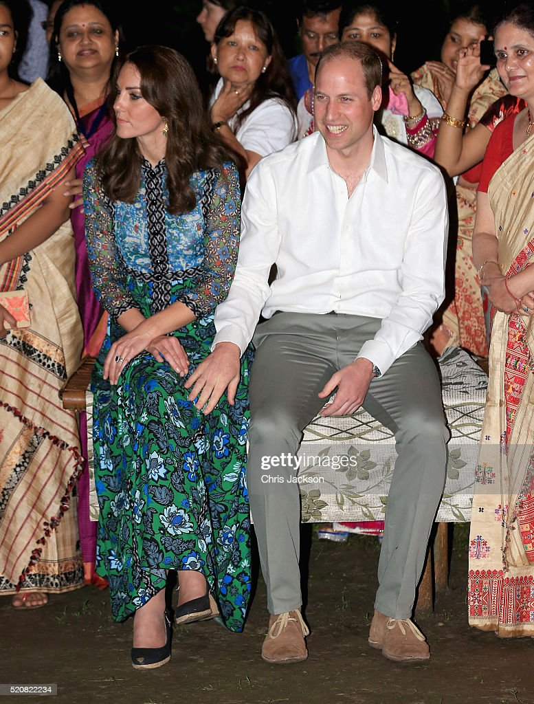 Catherine, Duchess of Cambridge and Prince William, Duke of Cambridge watch dancing by the fireside during a Bihu Festival Celebration at Diphlu River Lodge on day 3 of the royal visit to India and Bhutan on April 12, 2016 in Kaziranga, India. The Duke and Duchess of Cambridge are on a week-long tour of India and Bhutan taking in Mumbai, Delhi, Assam, Bhutan and Agra.