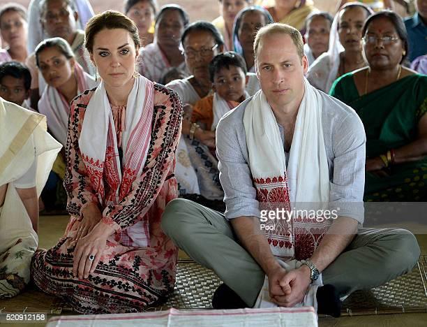 Catherine Duchess of Cambridge and Prince William Duke of Cambridge visit Pan Bari Village in the Kaziranga National Park meet villagers look at a...