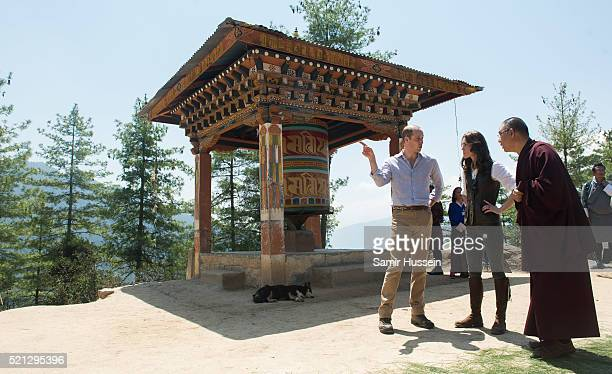 Catherine Duchess of Cambridge and Prince William Duke of Cambridge stop by a prayer wheel on their way to Paro Taktsang the Tiger's Nest monastery...